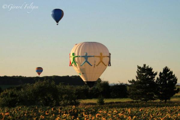Hot air balloon baptism at sunset
