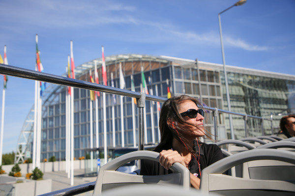 Woman exploring Luxembourg City on a double decker bus