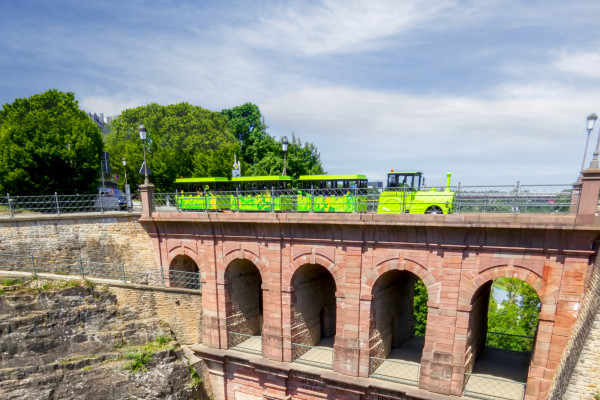 small touristic train Pétrusse Express on the bridge Schlassbreck in Luxembourg City