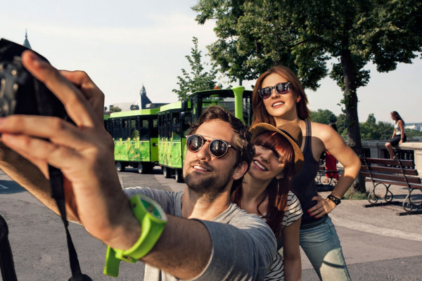 Tourists taking a selfie in front of the Pétrusse Express