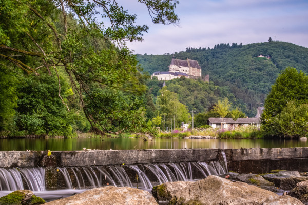 Waterfall in Vianden with view of the castle