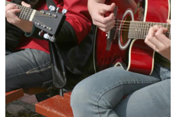 Akustikgitarrenspieler